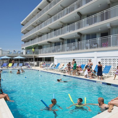 Guests swimming in pool outside Armada by the Sea in Wildwood NJ