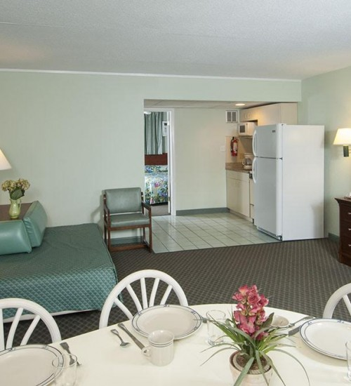 Armada by the sea living room and kitchen in deluxe ocean view three-room family hotel suite in Wildwood NJ
