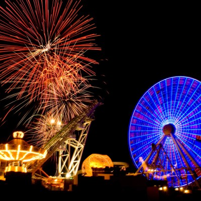 Fireworks and big ferris wheel at night at Morey's Piers boardwalk in Wildwood NJ