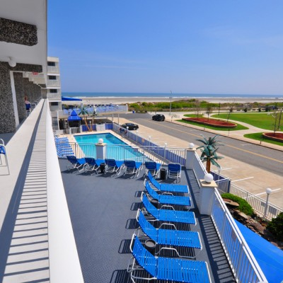 Balcony overlooking sundeck and Wildwood beach at Armada By the Sea