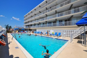 Guests swimming in Armada By the Sea's oceanfront pool in Wildwood NJ