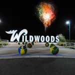 Wildwood NJ Sign at night and fireworks on the beach